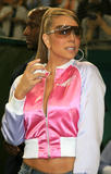 Mariah Carey shows legs in short jeans shorts and peek of cleavage wearing unzipped jacket as she throws the ceremonial first pitch before Japanese professional baseball match at Tokyo Dome in Tokyo